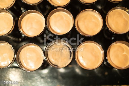 913660988istockphoto Beer glasses with dark beer are on the bar counter 1083089564