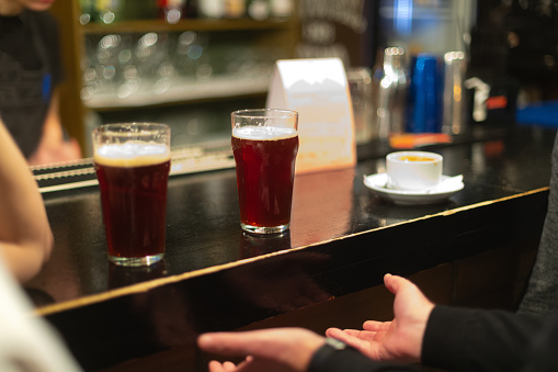 913660988 istock photo Beer glasses with dark beer are on the bar counter 1083089612