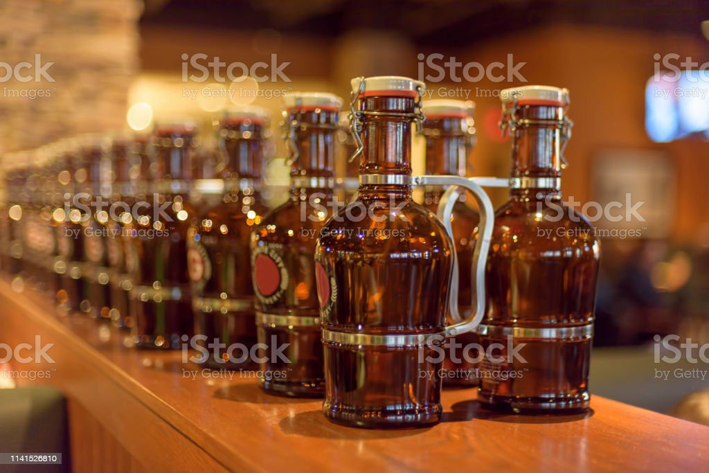 Beer growlers lined up on the bar stock photo