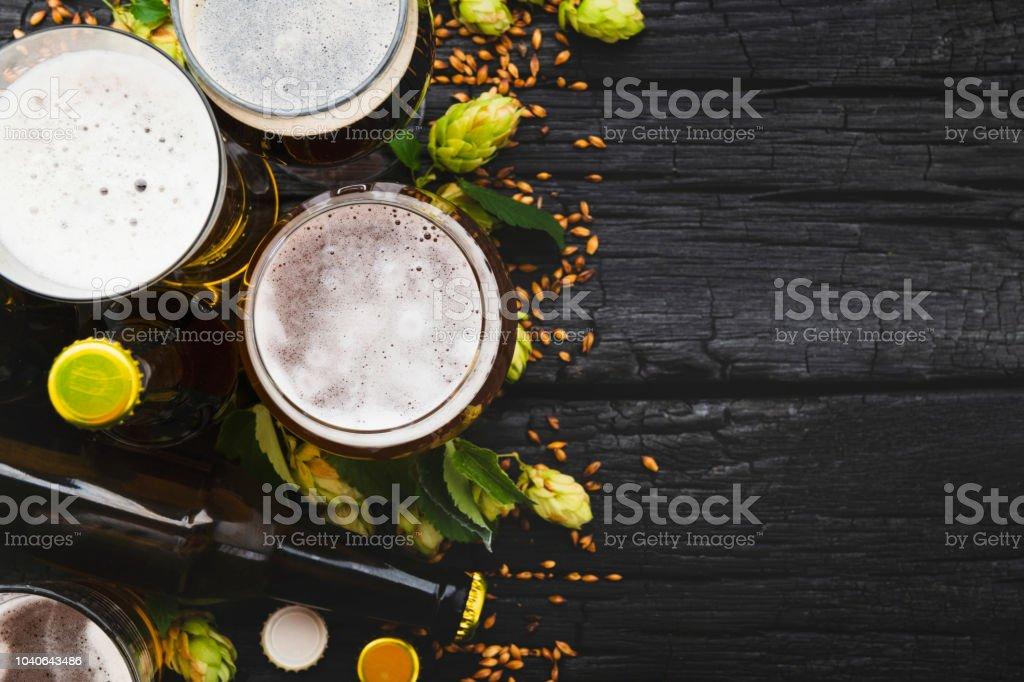 Beer in a glass with green hops and space for text. Top View stock photo
