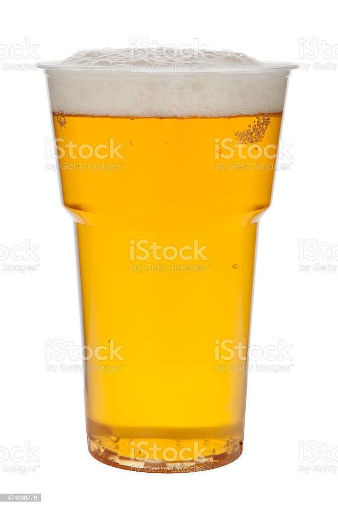 Beer in a plastic cup isolated on a white background stock photo