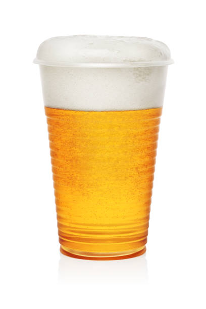 Beer in a plastic cup Golden beer in a plastic disposable cup or glass isolated on white background disposable cup stock pictures, royalty-free photos & images
