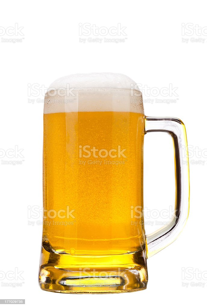 Beer in a stein mug filled to the top stock photo
