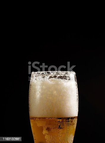 1073474208istockphoto beer in glass on black background 1163132881