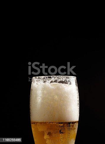1073474208istockphoto beer in glass on black background 1165255485