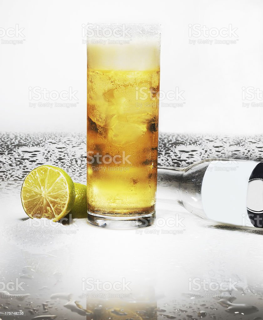 beer in glass with lemon a bottle and  reflection royalty-free stock photo