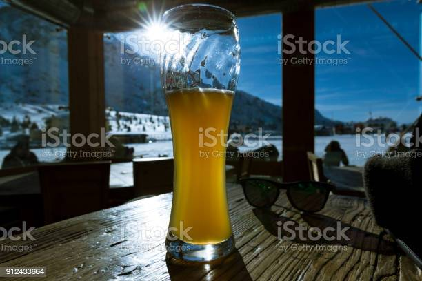 Photo of beer in italy alps at a bar
