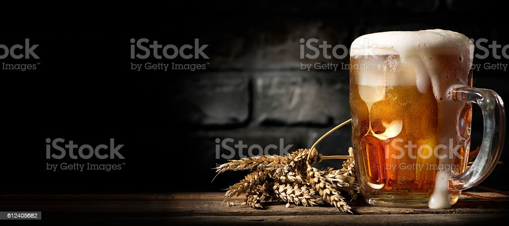Beer in mug on table stock photo