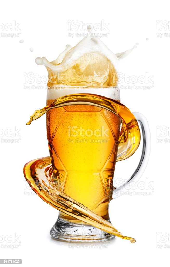 beer in mug with splash stock photo