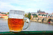 Pint of beer on the background of Prague (Czech Republic)