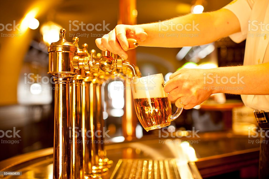 beer in the hand stock photo