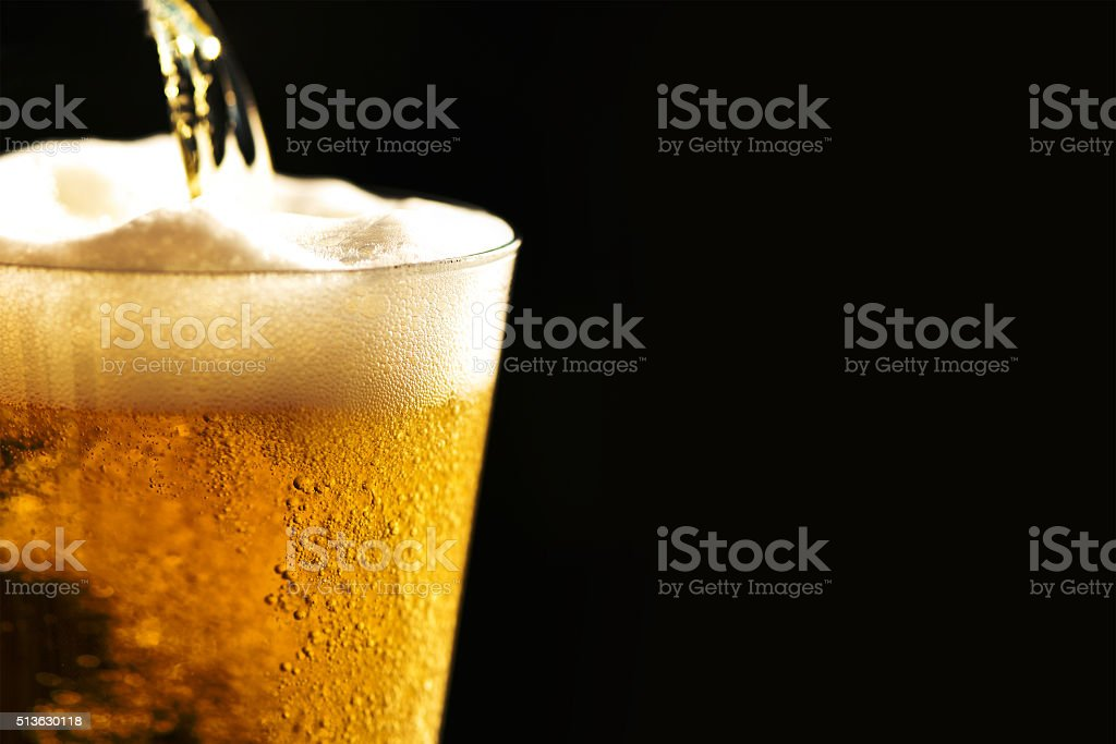 Beer into glass​​​ foto