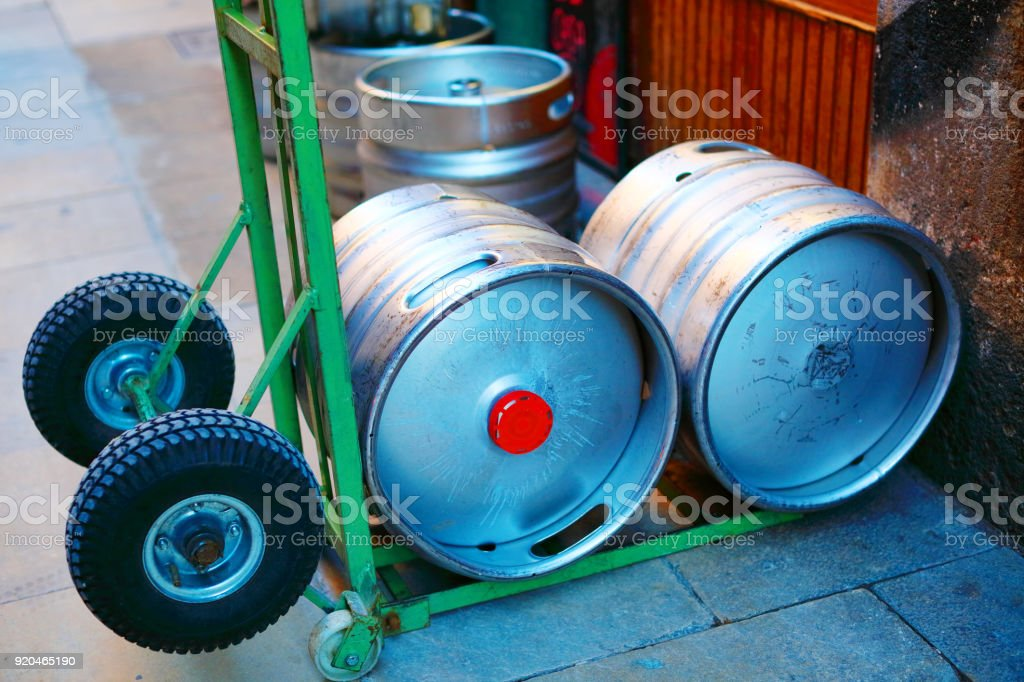 Beer kegs on the street. Barcelona, Spain. stock photo