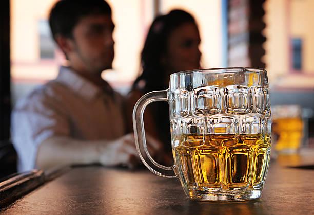 Beer mug on a bar counter stock photo