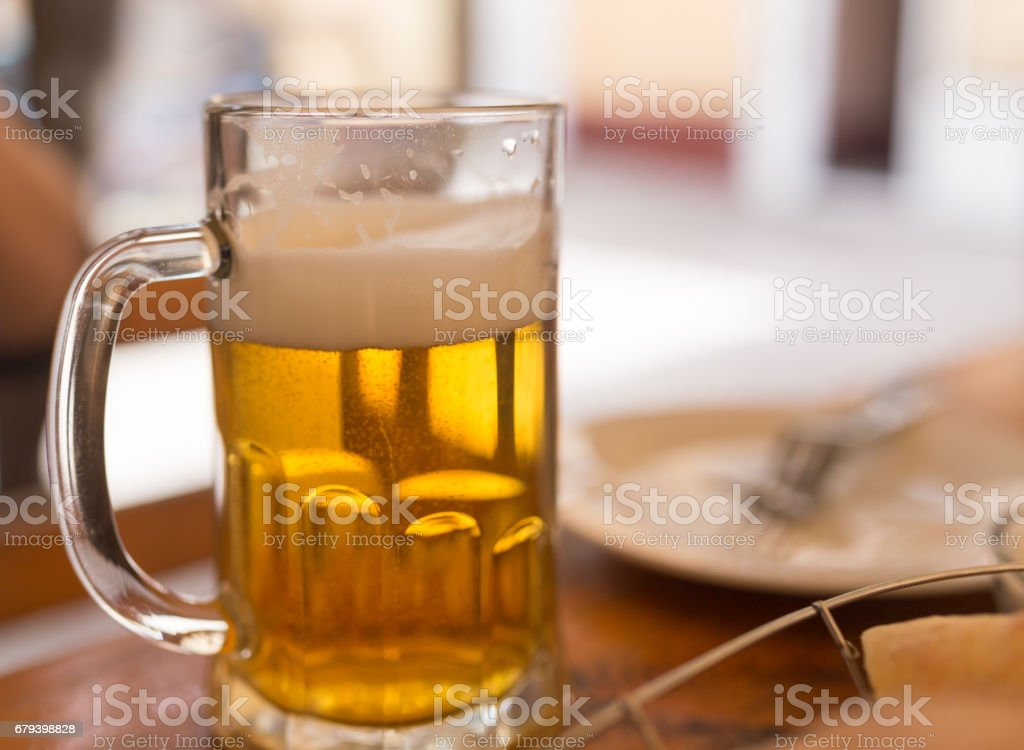 Beer mug on the table in a cafe royalty-free stock photo