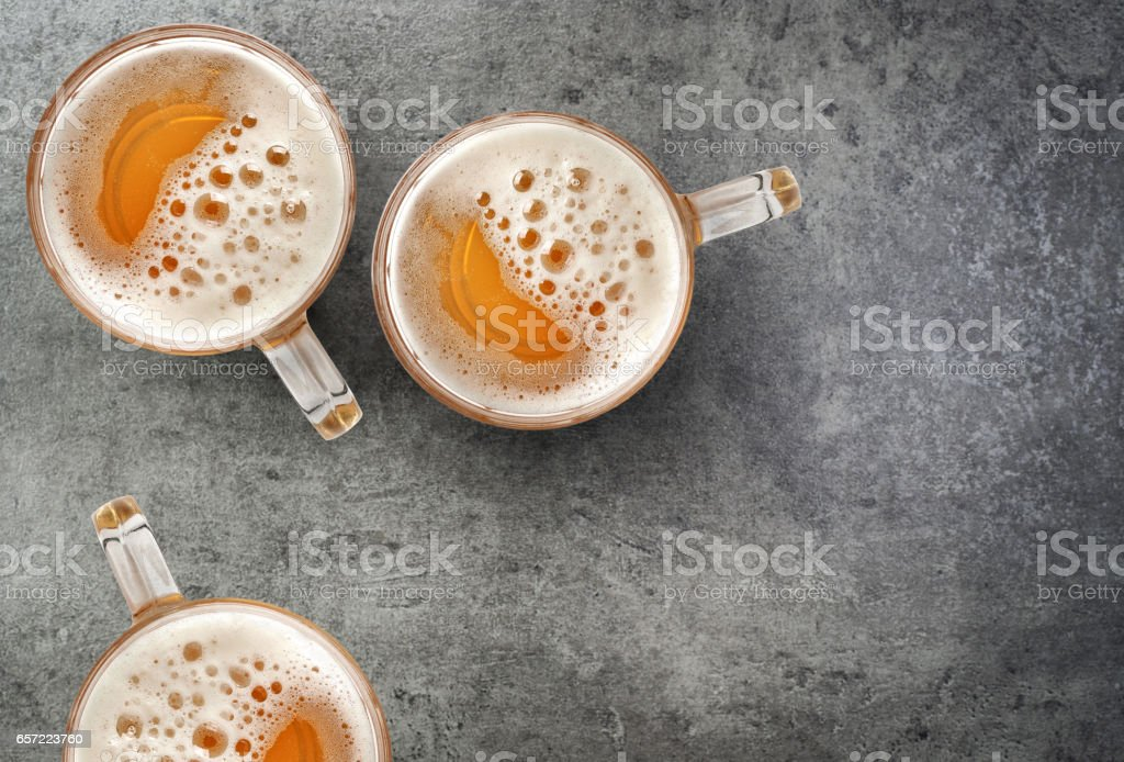 beer mugs on gray table stock photo