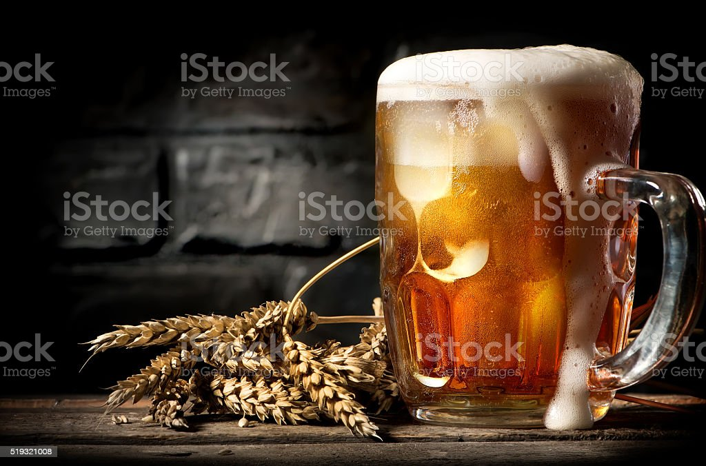Beer near brick wall stock photo