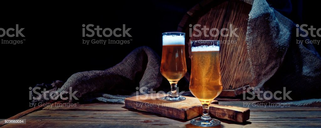 Beer next to the barrel stock photo