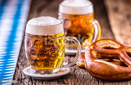 istock Beer. Oktoberfest.Two cold beers and pretzel. Draft beer. But draft. Golden beer. Golden however. Two gold beer with froth on top. Cold draft beer in glass jars in a hotel pub or restaurant. Still life 649126062