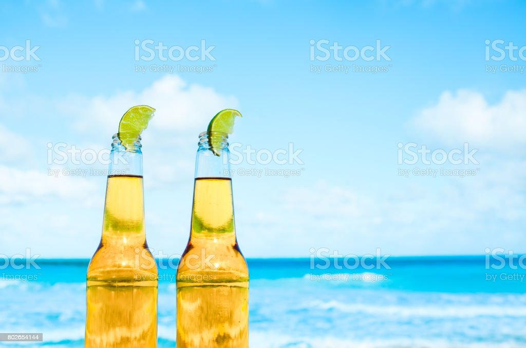 Beer on a beach stock photo