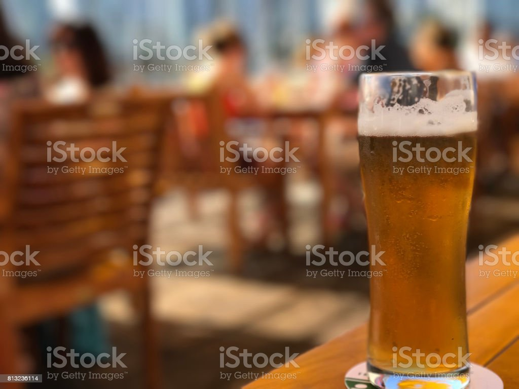 Beer on a patio stock photo