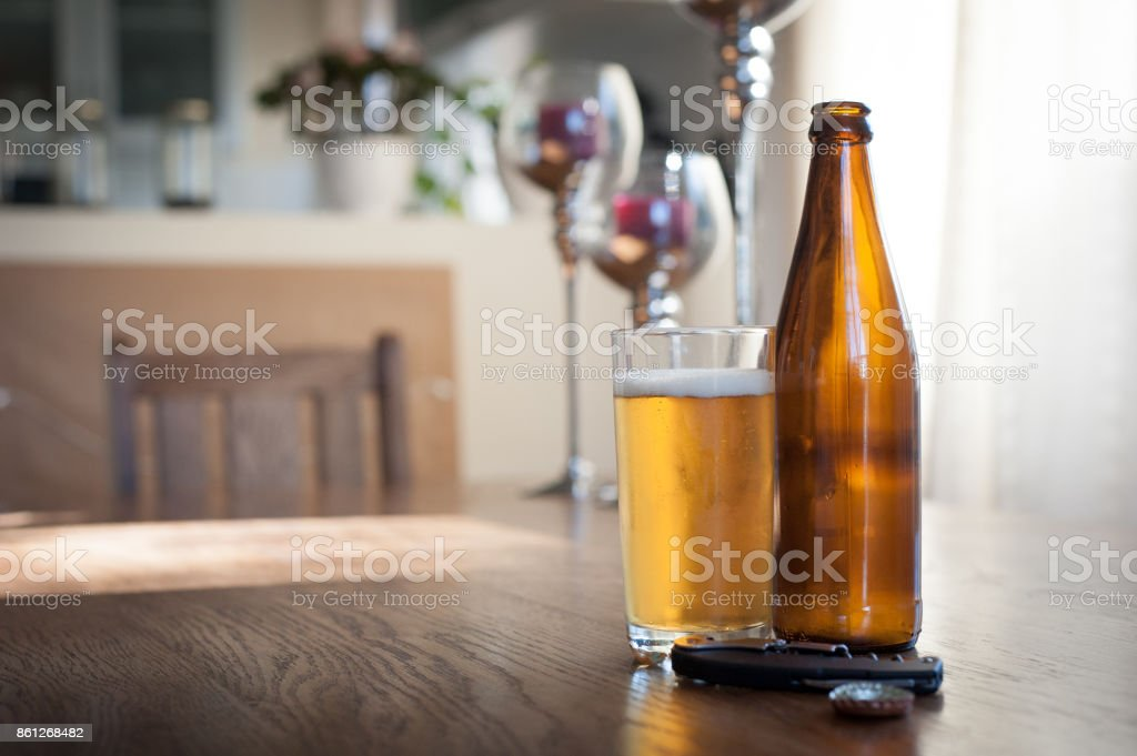 Beer on a wooden table in the home stock photo