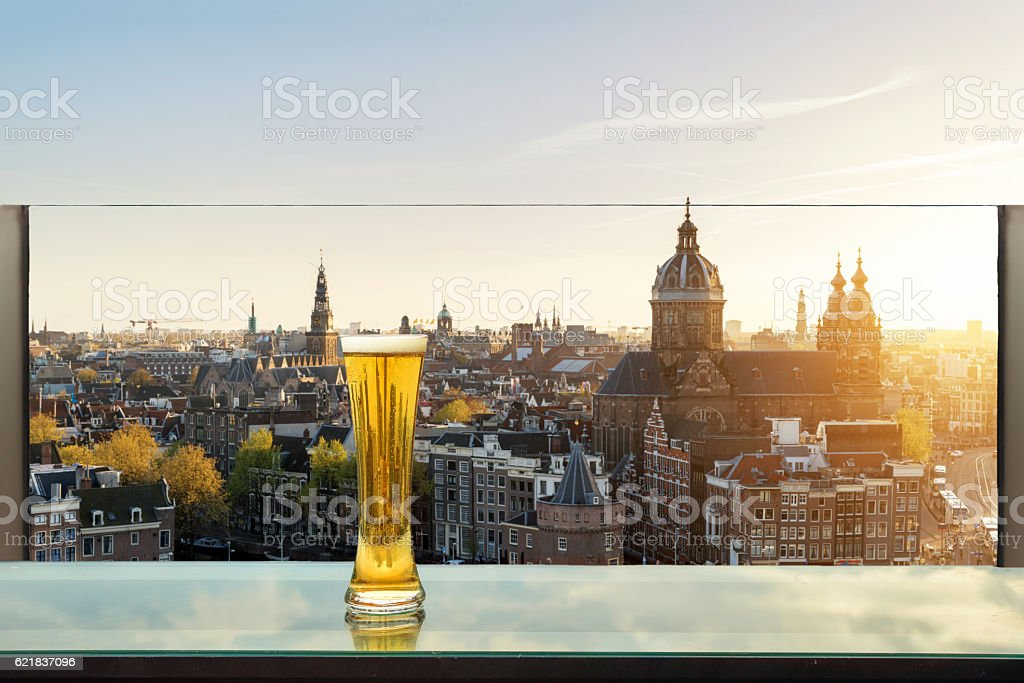 Beer on table in rooftop bar at Amsterdam, Netherlands. stock photo
