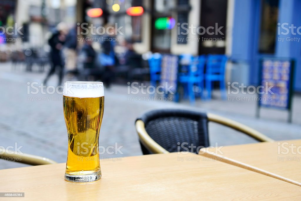 Beer on table in sidewalk cafe stock photo
