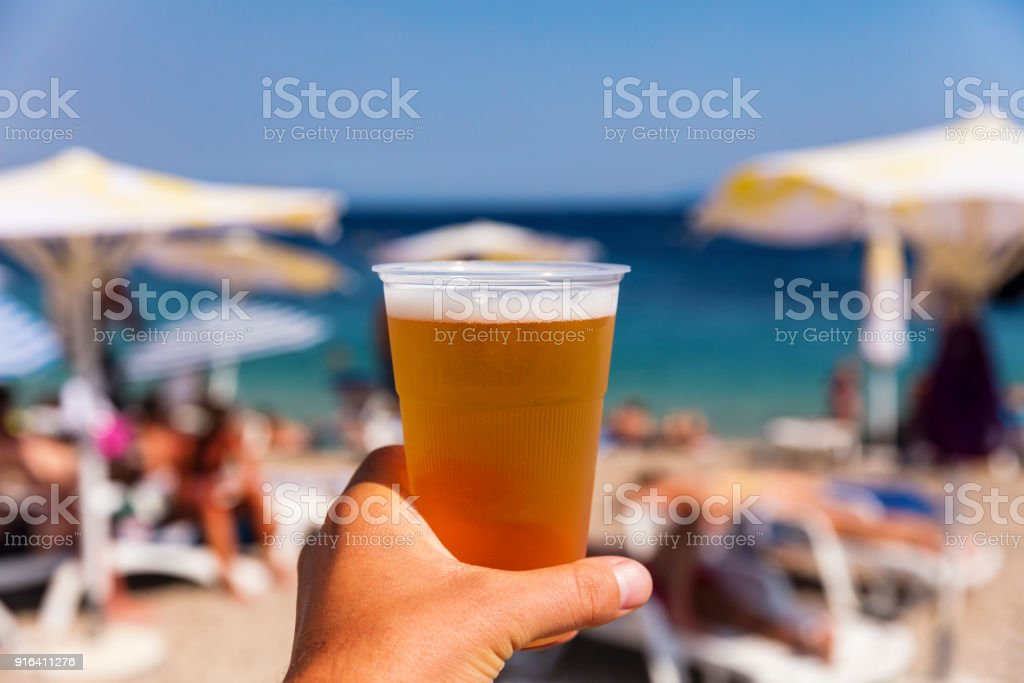 Beer on the beach on a sunny day stock photo