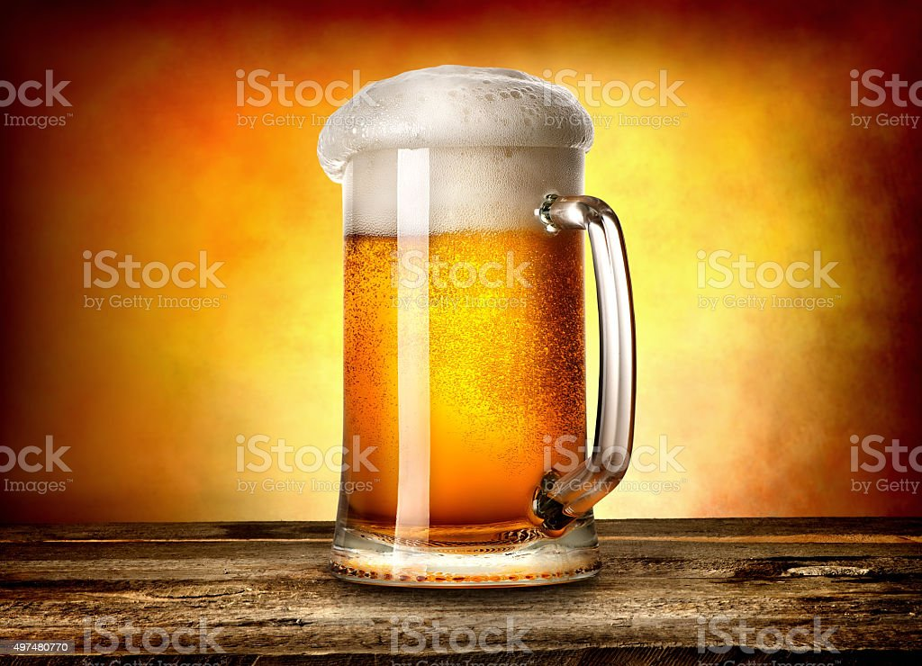 Beer on yellow background stock photo