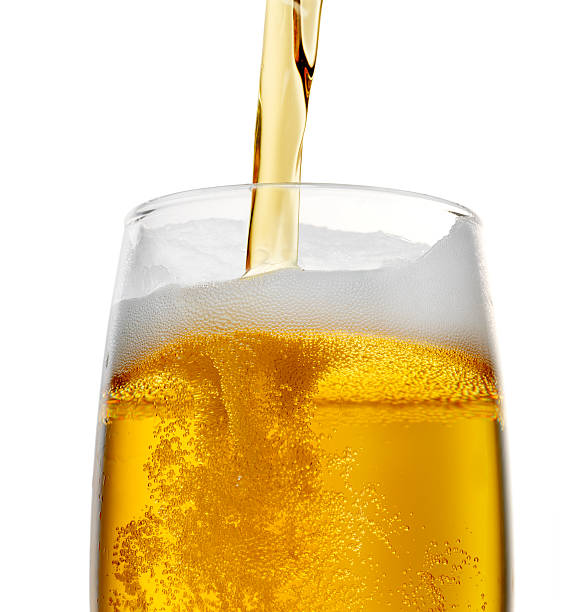 Beer Pouring beer into a glass on white background (+ clipping path) pouring stock pictures, royalty-free photos & images