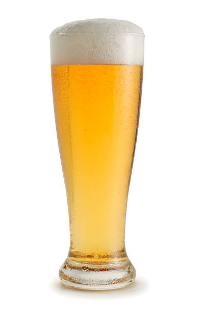 Beer Beer in a pilsner glass. Shot on white with soft shadow.  Clipping path included. pilsner stock pictures, royalty-free photos & images
