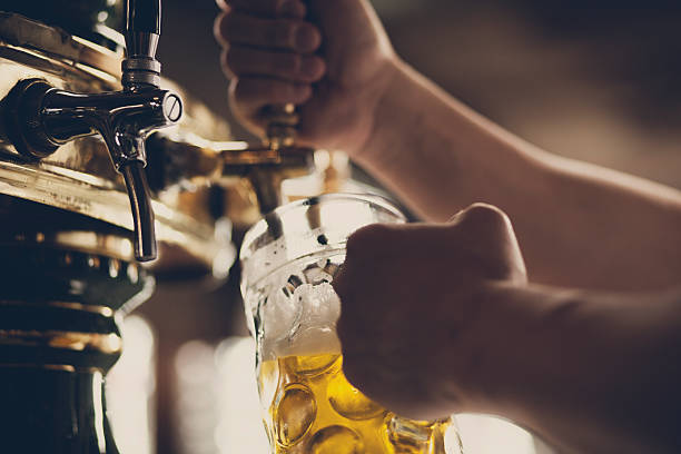 beer - beer pour stock photos and pictures