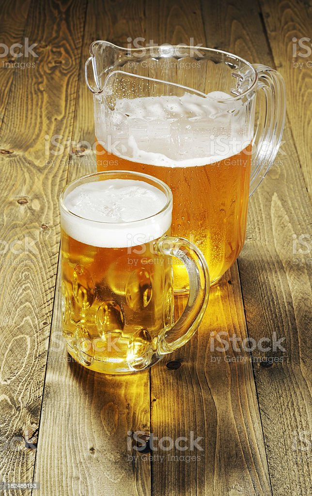 Beer pitcher and mug stock photo