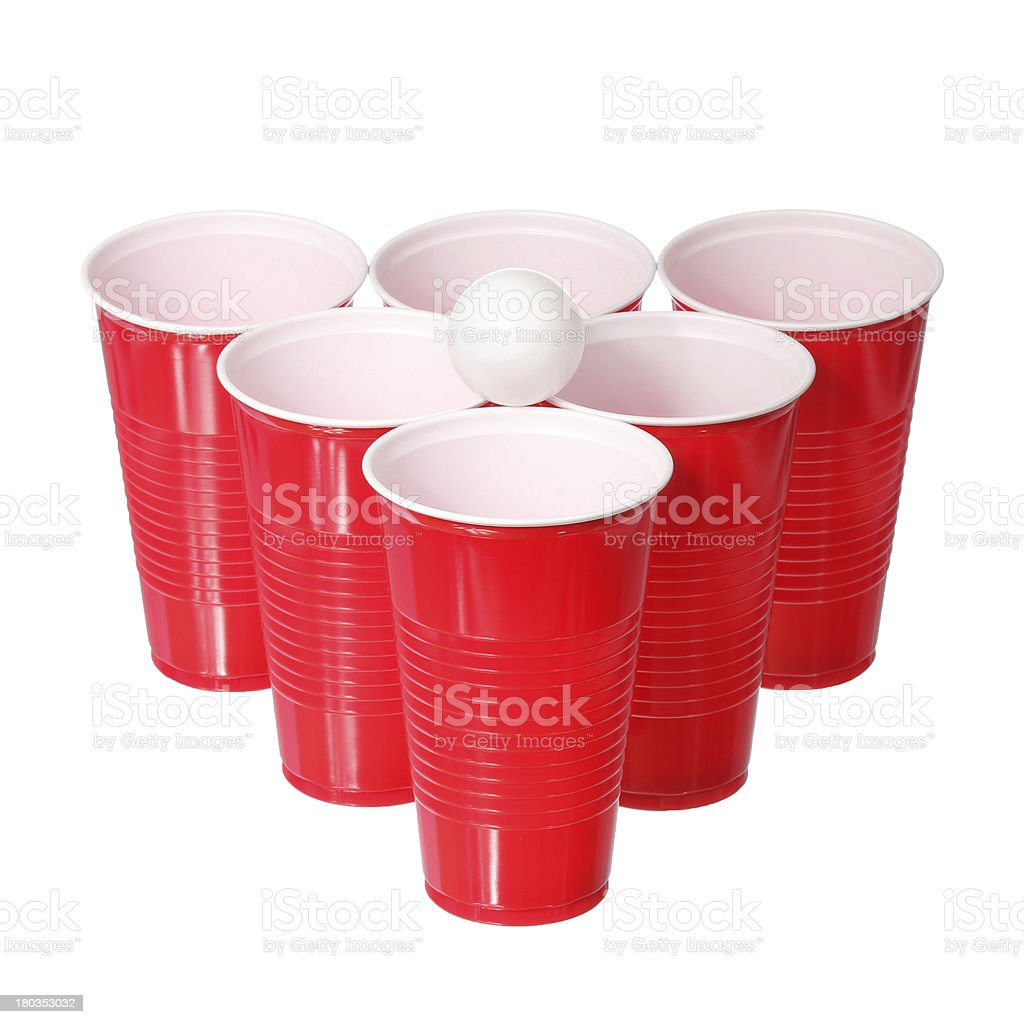 Beer pong. Red plastic cups and ball isolated stock photo