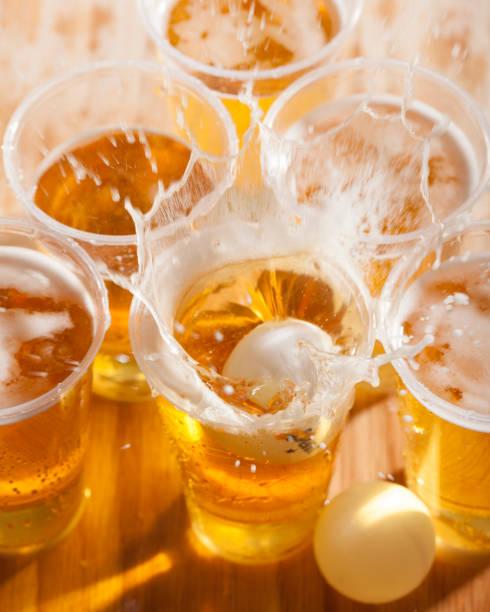 bier pong splash - beirut stockfoto's en -beelden