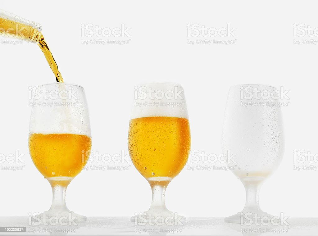 Beer pour in glass royalty-free stock photo