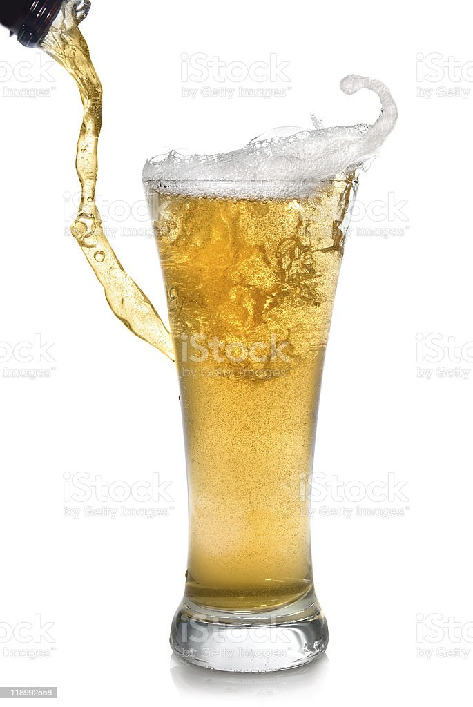 Beer pouring from bottle into glass royalty-free stock photo