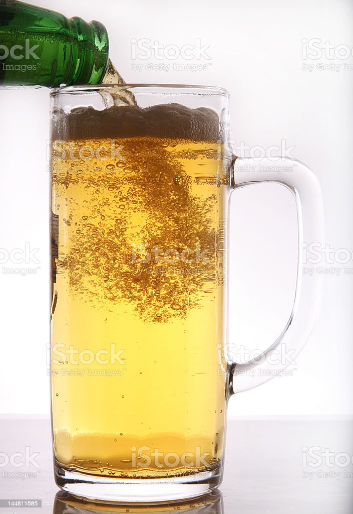 Beer Pouring In Glass Mug royalty-free stock photo