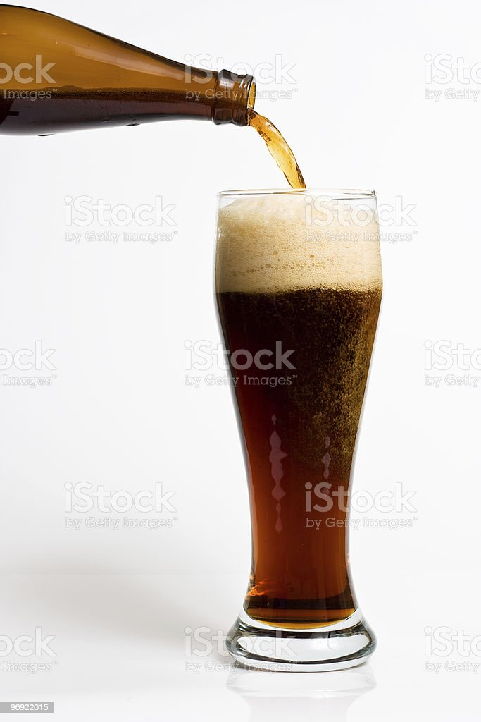 Beer pouring into a mag royalty-free stock photo