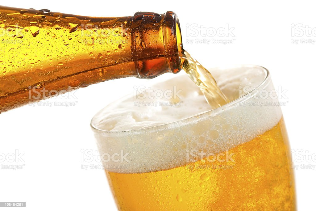 Beer pouring into glass stock photo
