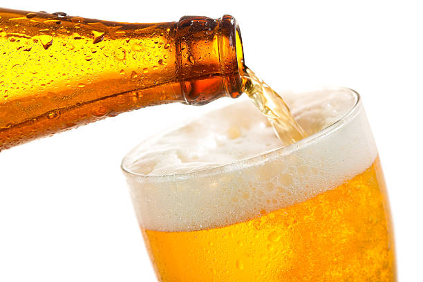 beer pouring into glass - beer pour stock photos and pictures