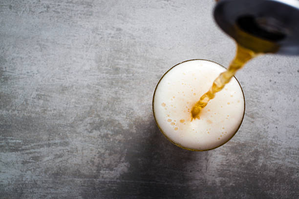 beer pouring out of a can into a glass - beer pour stock photos and pictures