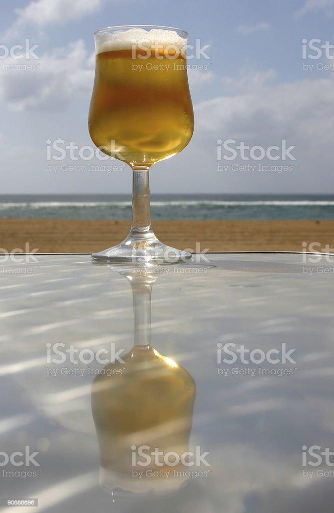 Beer Reflected by Beach royalty-free stock photo