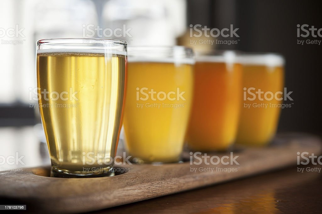 Beer sampler with four different choices of beer brands stock photo