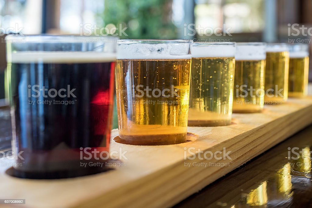 Beer samplers in unique wooden tray stock photo