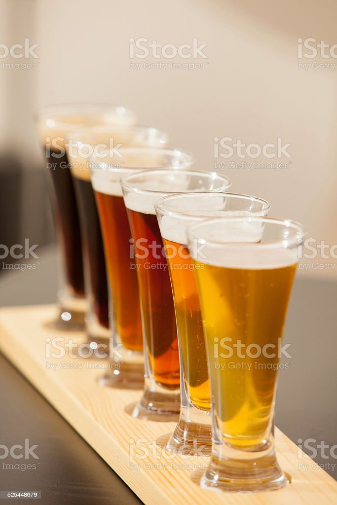 Beer samplers lined up on a bar. stock photo