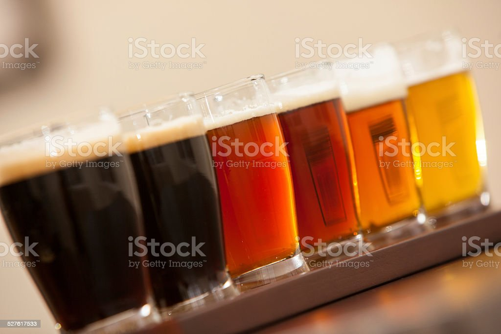 Beer samples lined up on a bar stock photo