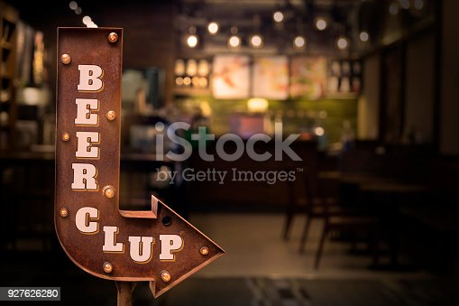 istock Beer signboard, in front of the bar 927626280
