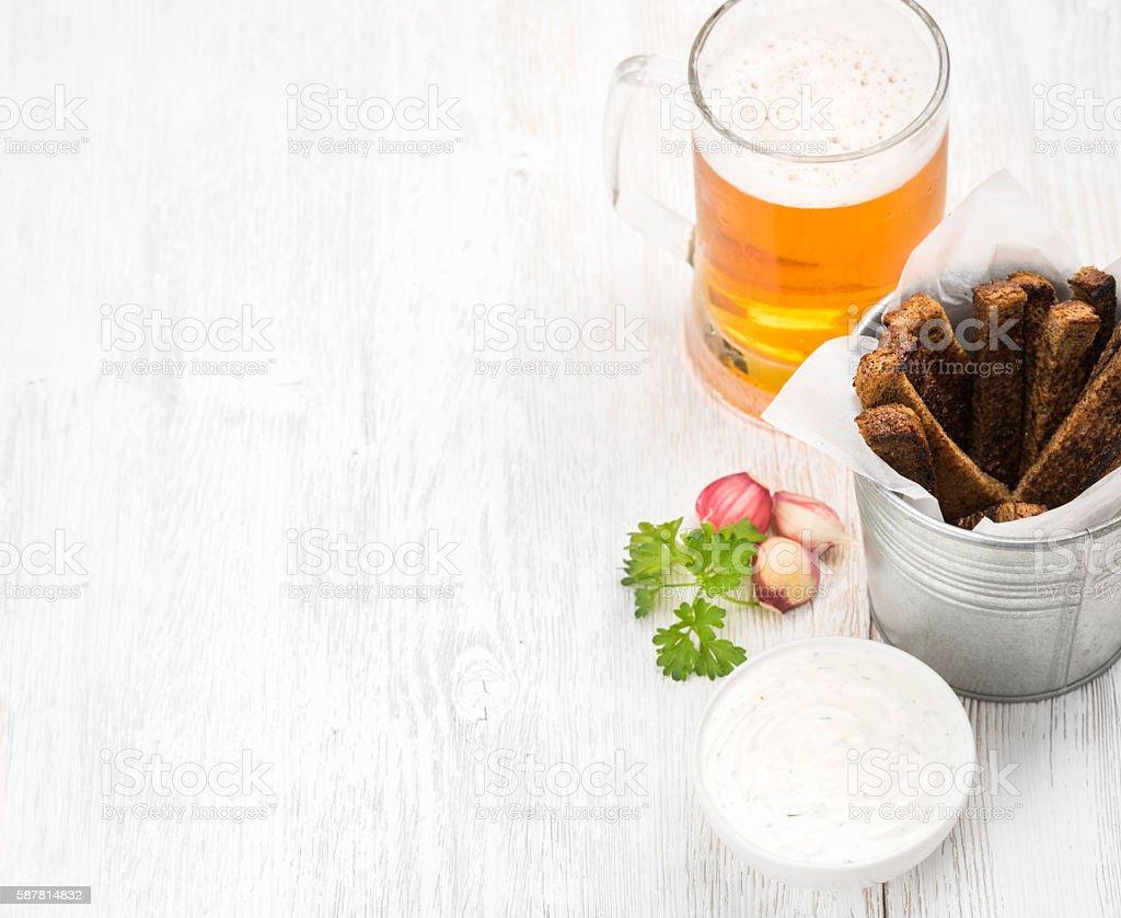 Beer snack set. Pint of pilsener in mug and rye stock photo
